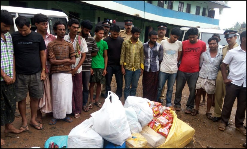 Excise team with migrant labourers after a raid at a labour camp in Perumbavoor. Firstpost/Naveen Nair