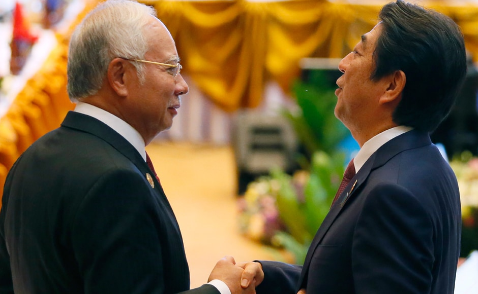 Malaysia's Prime Minister Najib Razak, left, greets Japan's Prime Minster Shinzo Abe prior to the ASEAN Plus Japan meeting in the ongoing 28th and 29th ASEAN Summits at the National Convention Center. AP