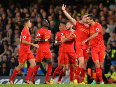 Jordan Henderson scored a screamer to give Liverpool a 2-1 win over Chelsea at Stamford Bridge. AFP