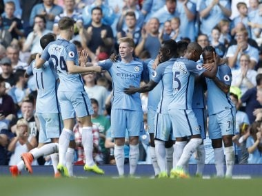 Manchester City's Ilkay Gundogan celebrates scoring their fourth goal with teammates. Reuters