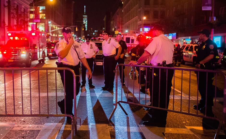 Police work near the scene of an explosion in Manhattan's Chelsea neighborhood. An explosion in a crowded Manhattan neighborhood on Saturday night left more than two dozen people injured, and authorities said a second nearby site was also being investigated. AP