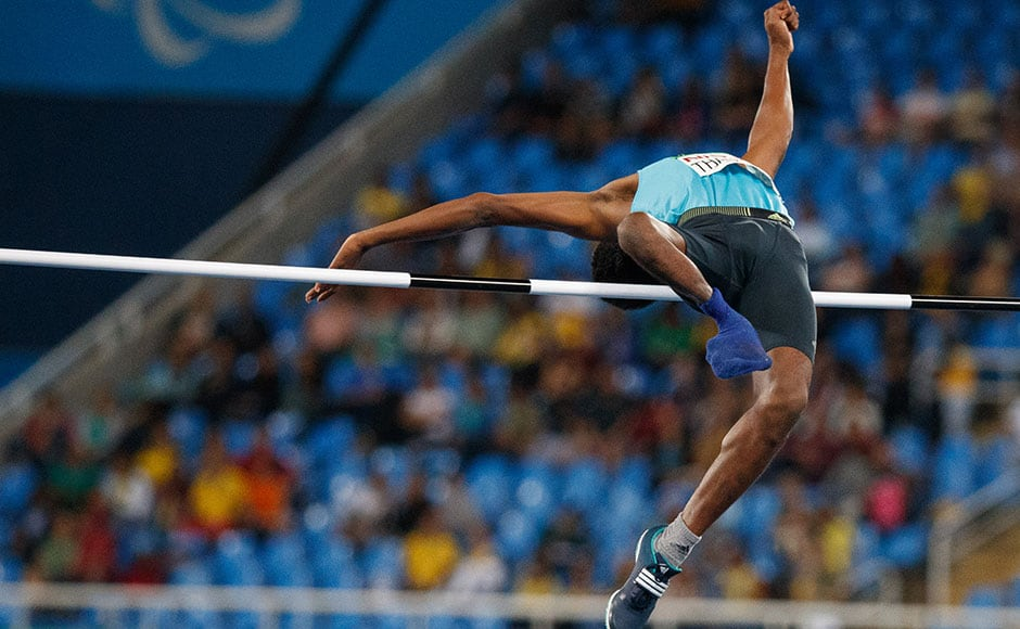 Handout image supplied by OIS/IOC showing Mariyappan Thangavelu of India, the gold medallist in the men's high jump - T42 Final in the Olympic Stadium during the Paralympic Games in Rio de Janeiro, Brazil, on September 9, 2016. Photo by Simon Bruty/OIS/IOC via AFP. RESTRICTED TO EDITORIAL USE / AFP PHOTO / OIS/IOC AND AFP PHOTO / Simon Bruty for OIS / Photo by Simon Bruty/OIS/IOC via AFP. RESTRICTED TO EDITORIAL USE