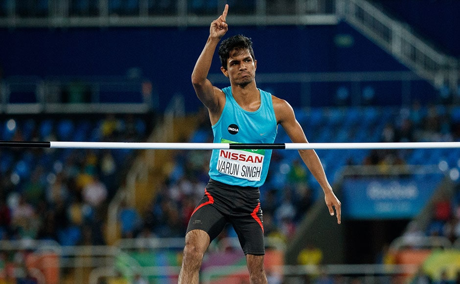 India's Varun Singh Bhati acknowledges the support during the men's high jump event where he bagged a bronze medal. AFP