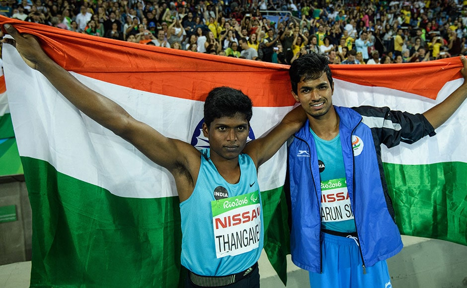 India's Mariyappan Thangavelu (L) and Bhati Varun Singh celebrate their gold and bronze medals, respectively, after the men's final high jump. AFP