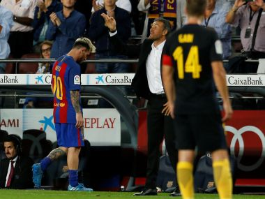 Barcelona's Lionel Messi leaves the pitch next to coach Luis Enrique. Reuters