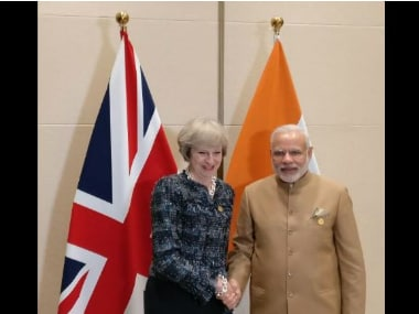 Prime Minister Narendra Modi with British PM Theresa at G20 Summit. Twitter @MEASwarup