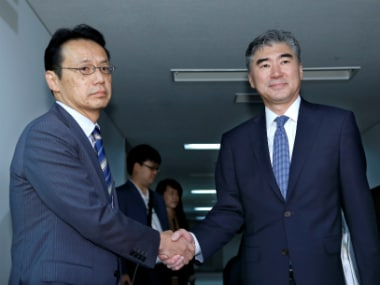 North Korea Policy Ambassador Sung Kim (R) shakes hands with Japanese Foreign Ministry's Director-General Kenji Kanasugi prior to a meeting in Tokyo on Sunday. Reuters