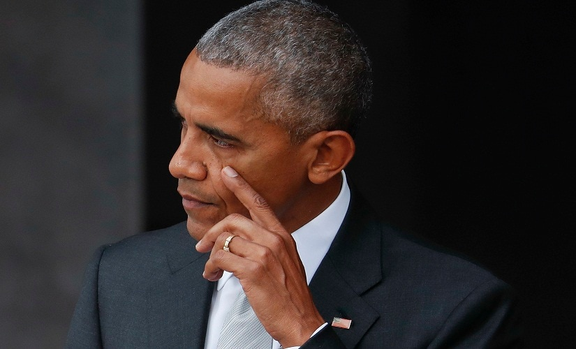 President Barack Obama wipe a tear from his cheek while speaking at the dedication ceremony for the Smithsonian Museum of African American History and Culture on the National Mall in Washington, Saturday, Sept. 24, 2016. (AP Photo/Pablo Martinez Monsivais)