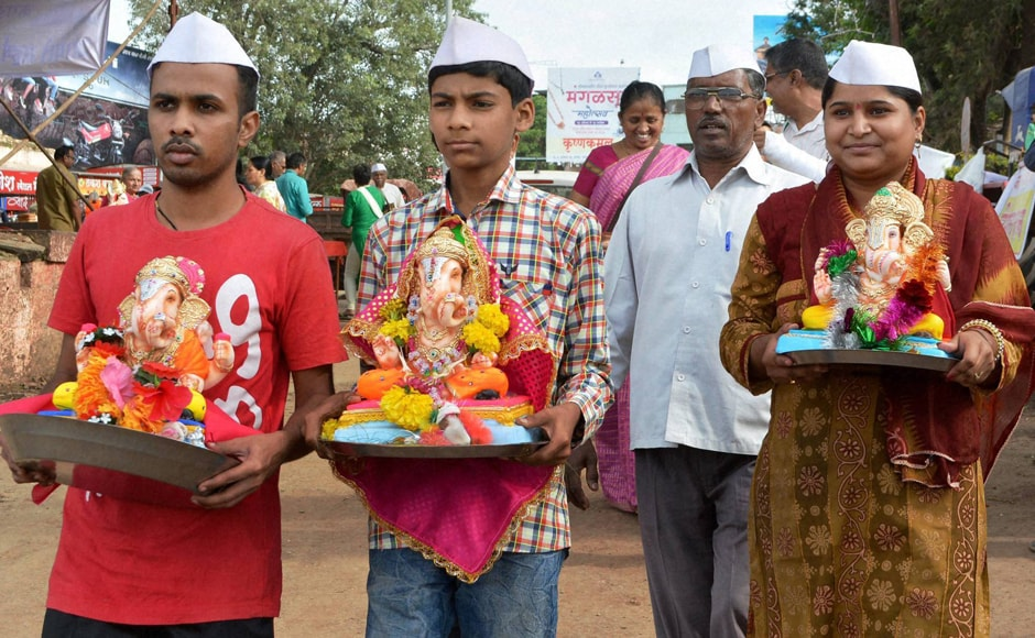 Devotees carry Ganesh idols for immersion in Karad, Maharashtra on Saturday. (Photo courtesy: PTI)