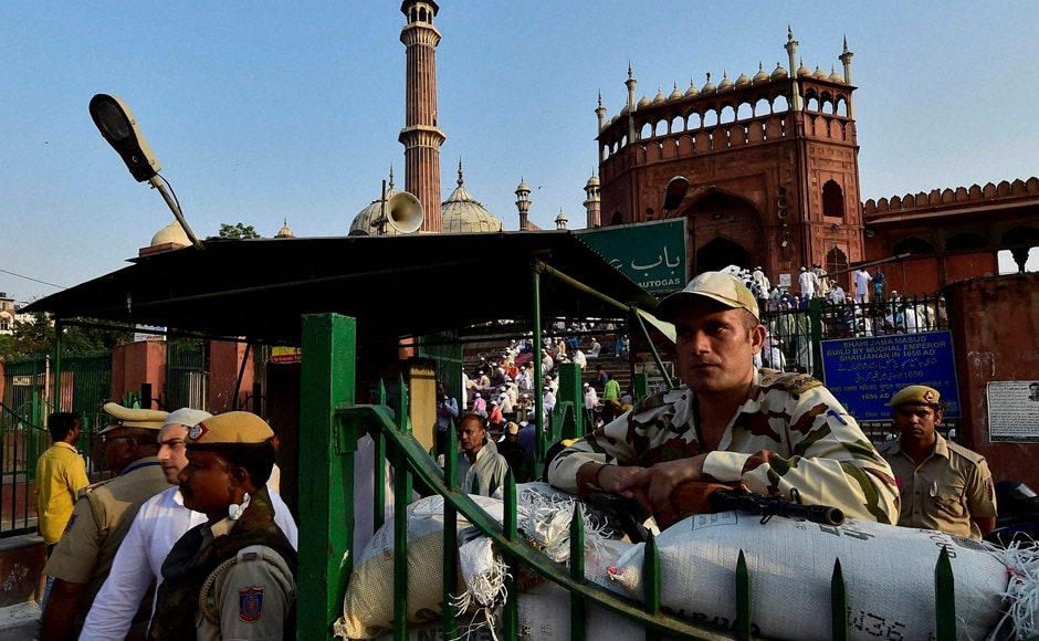 Eid commemorates this extraordinary display of faith in Allah and Muslims celebrate it by sacrificing animals on this day. Security men stand guard outside Delhi's Jama Masjid during Eid prayers on Tuesday. (Photo: PTI)