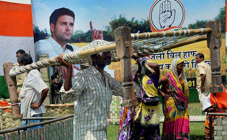 Just a week ago Congress vice-president Rahul Gandhi's khat sabha in Deoria, Uttar Pradesh ended with locals fleeing with the free cots, not surprisingly it happened again during his another khat sabha Mirzapur. People are seen running away cots after Gandhi's 'Khat Pe Charcha' programme as part of his Kisan Yatra at Bihasara Village in Mirzapur on Wednesday. (Photo: PTI)