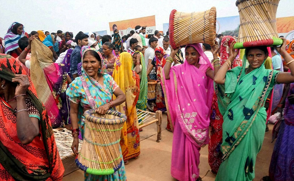 Congress party supporters gleefully take away Modas (Cane stools) after the Khat pe Charcha programme ended in Mirzapur on Wednesday. (Photo: PTI)