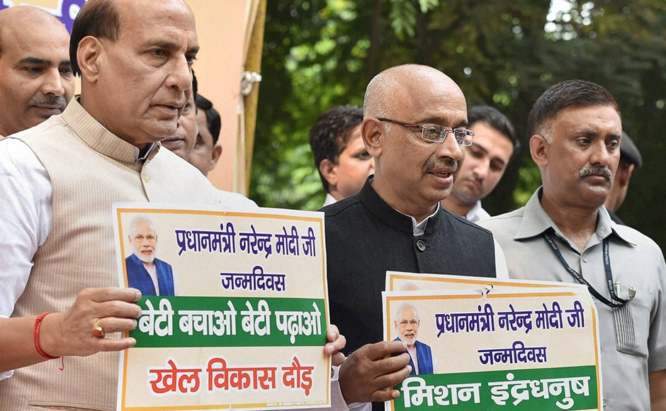 Home Minister Rajnath Singh with Sports Minister Vijay Goel during the flag off ceremony of Khel Vikas run on the occasion PM Modi's birthday. PTI