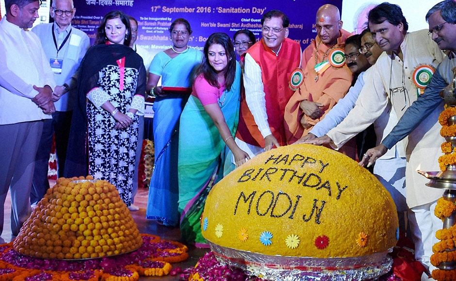 Union Minister Suresh Parbhu unveils a Laddu at the inauguration of Swacchata Diwas function to mark the birthday of Prime Minister Narendra Modi at Mavlankar Hall in New Delhi on Saturday. PTI