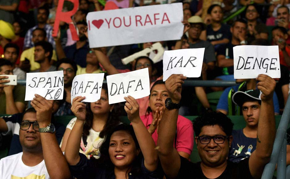 The home crowd seemed to have mixed sentiments about watching Nadal, one of the most popular tennis stars, play against India, as the contrasting banners suggest. PTI