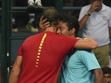 Spain's Rafael Nadal and India's Leander Paes after the doubles match. PTI