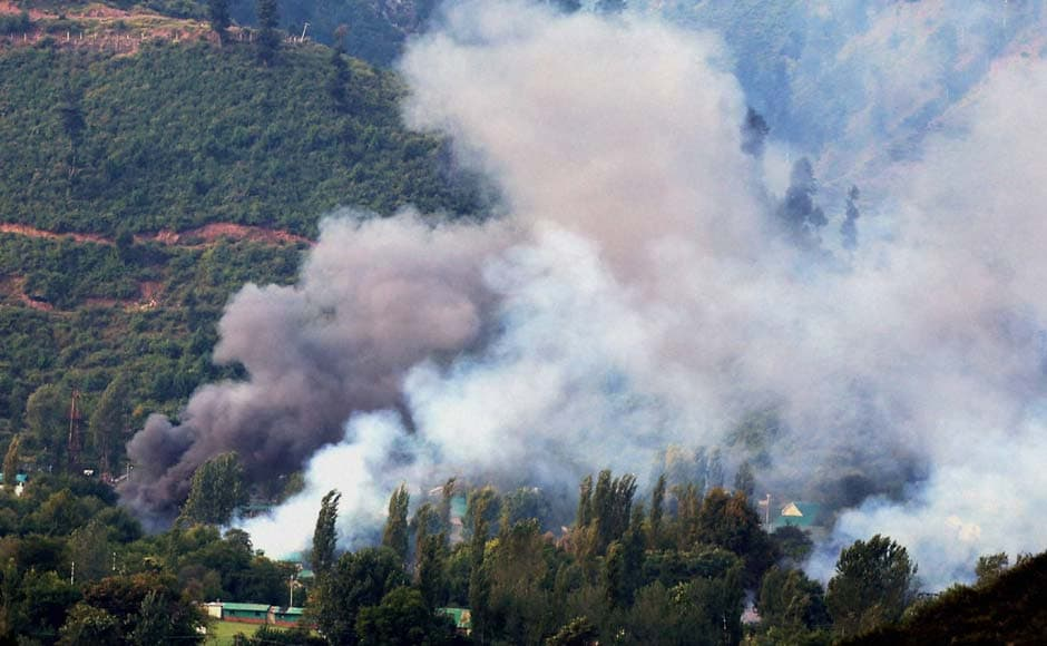 Seventeen soldiers and four militants were killed on Sunday during an attack on an army camp in Jammu and Kashmir's Uri town. In this photo, smoke rises from the Army Brigade camp in Uri. PTI