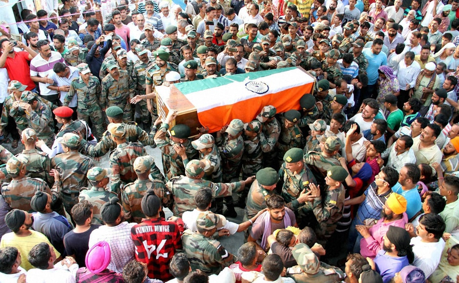 Army jawan carry the mortal remains of Havildar Ravi Paul at his native village, Sarwa in Samba on Monday. Ravi Paul was martyred in terrorist attack at the Army Camp at Uri near LoC. PTI