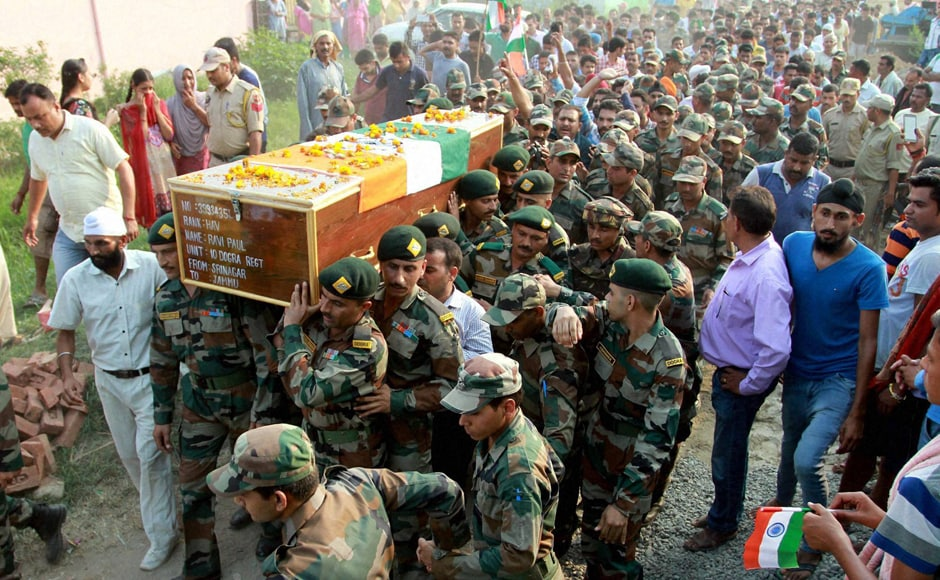 Soldiers carry the mortal remains of Havildar Ravi Paul at his native village, Sarwa in Samba on Monday. Ravi Paul was martyred in terrorist attack at the Army Camp at Uri near LoC. PTI
