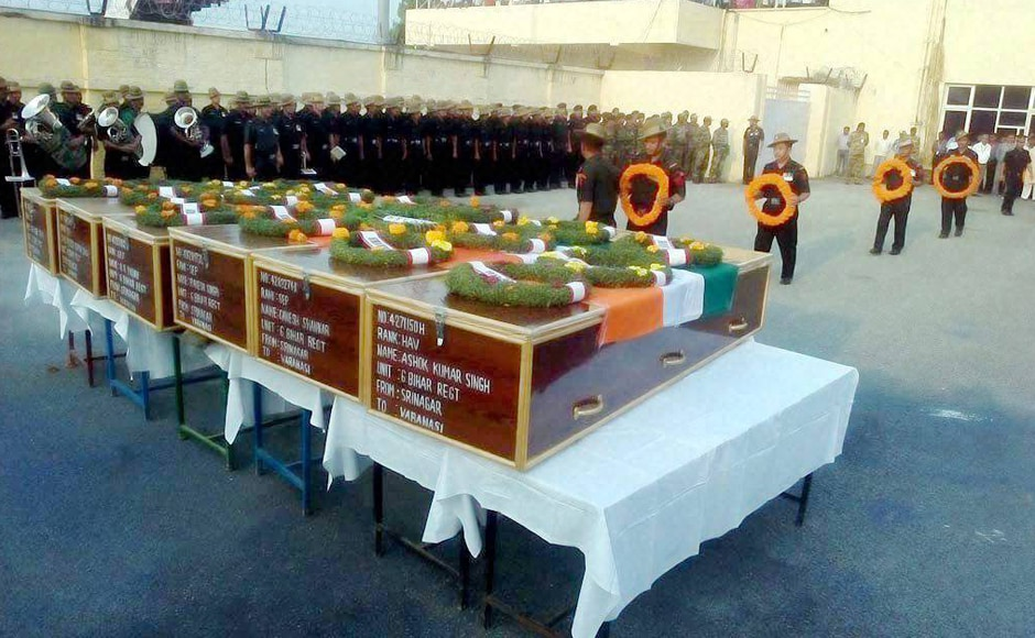 Army officers pay homage to seven army soldiers who were killed in the Uri attack, at Babatpur Airport in Varanasi on Monday. PTI
