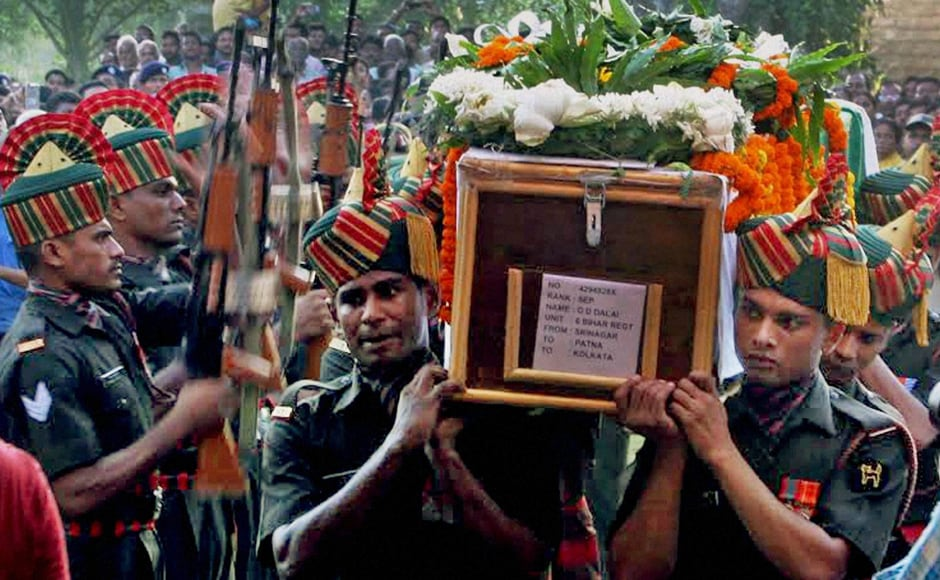 Army jawans carry the coffin of Sepoy Gangadhar Dolui, who was martyred in Uri attack, in Howrah on Tuesday. PTI