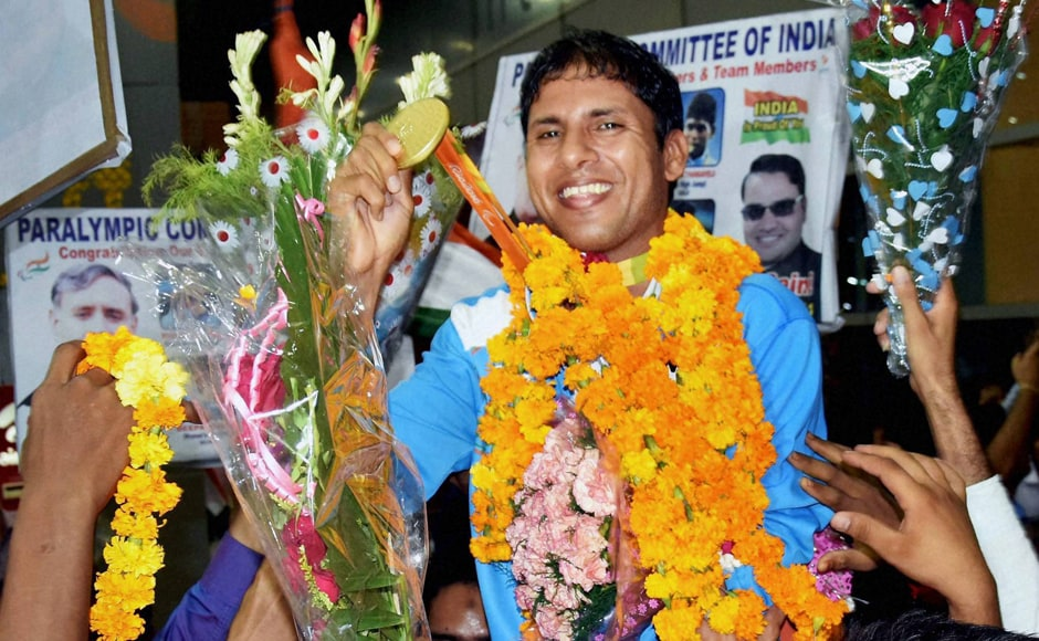 Para Olympic medal winner Devendra Jhajharia being welcomed on his arrival at IGI airport in New Delhi on Thursday. PTI