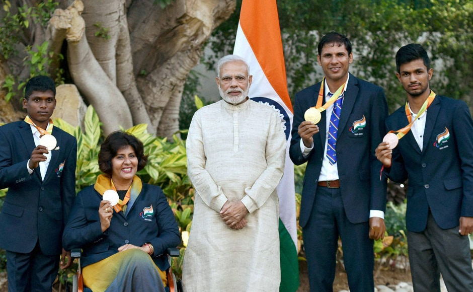 Prime Minister Narendra Modi with the medal winners of the Rio Paralympics 2016. PTI