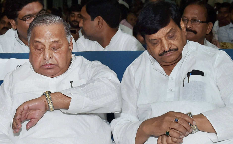 Prajapati's re-induction on the cards is a part of a compromise formula to douse the flames in the Yadav clan that took the hue of a major political crisis recently where Mulayam Singh Yadav (left) removed his son, Akhilesh Yadav as state party chief and then the Chief Minister stripped his uncle Shivpal Yadav (right) of four key portfolios. Both were present at the oath-taking ceremony. (Photos: PTI)
