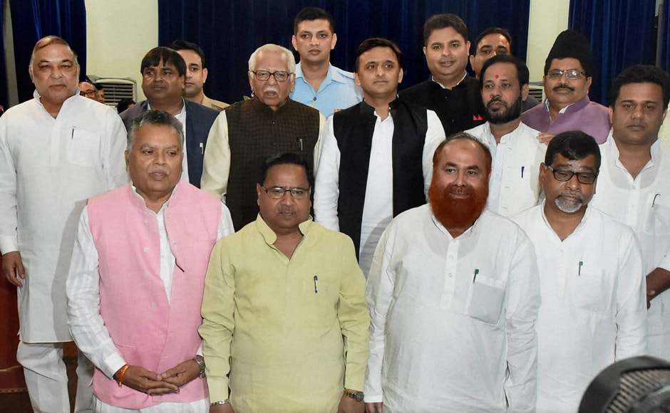 The swearing-in of 10 new ministers, including Gayatri Prasad Prajapati, Manoj Pandey and Shivakant Ojha, who were all sacked by the CM earlier, was conducted at Raj Bhavan by Governor Ram Naik. CM Akhilesh Yadav with the newly sworn-in ministers after their oath taking ceremony in Lucknow on Friday. The Akhilesh ministry now comprises 32 cabinet ministers, 9 MoS (Independent charge) and 19 MoS. (Photo: PTI)