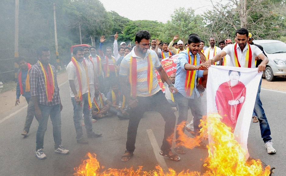 Protesters held road blockades and dharnas at several places. Activists also burnt posters of Tamil Nadu CM J Jayalalithaa during the agitation. Photo: PTI