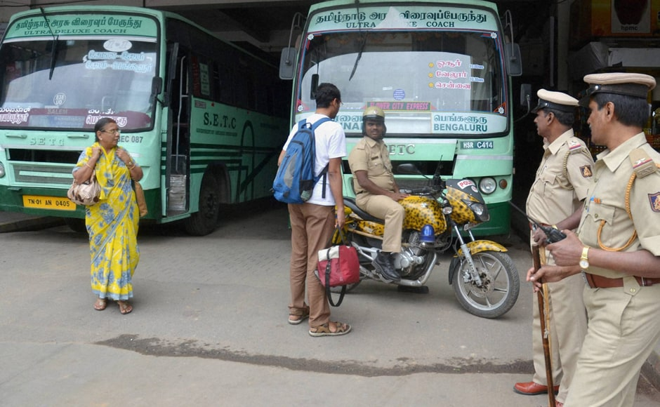 Passengers were left stranded at Shantinagar Bus Stand as Tamil Nadu State Transport Corporation buses were stopped due to Kannada Organizations' protest. Photo: PTI
