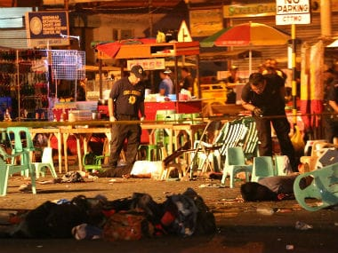 Police search the site of the explosion. AP