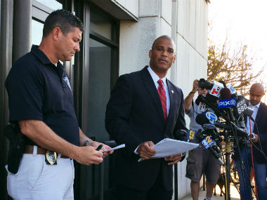 Police authorities speak about the pipe bomb. AP