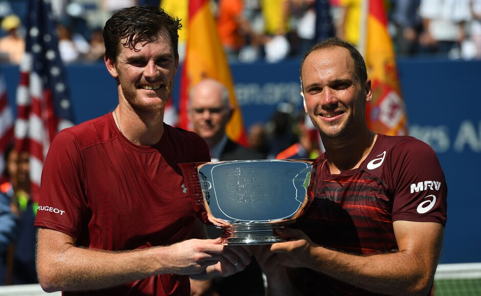 Jamie Murray and Bruno Soares celebrate with their US Open trophy after beating the Spanish duo of Pablo Carreno Busta and Guillermo Garcia-Lopez. Robert Deutsch/USA TODAY Sports