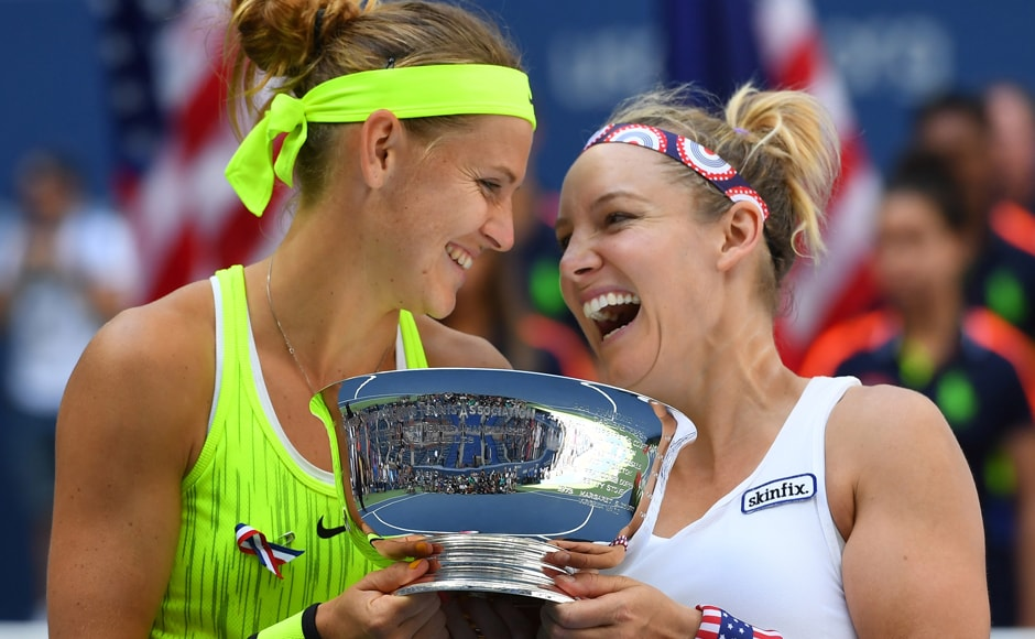 All smiles for Bethanie Mattek-Sands and Lucie Safarova as they celebrate beating French pair Caroline Garcia and Kristina Mladenovic in the women's doubles final. Robert Deutsch/USA TODAY Sports