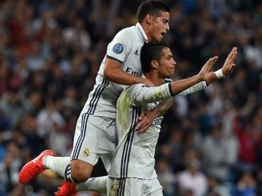 Cristiano Ronaldo (R) refused to celebrate his goal, instead acknowledging the praise from visiting crowds. AFP