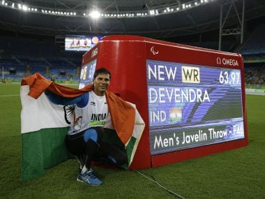 Devendra Jhajharia poses for the pictures next to the scoreboard that shows his world record in the men's javelin throw. AP
