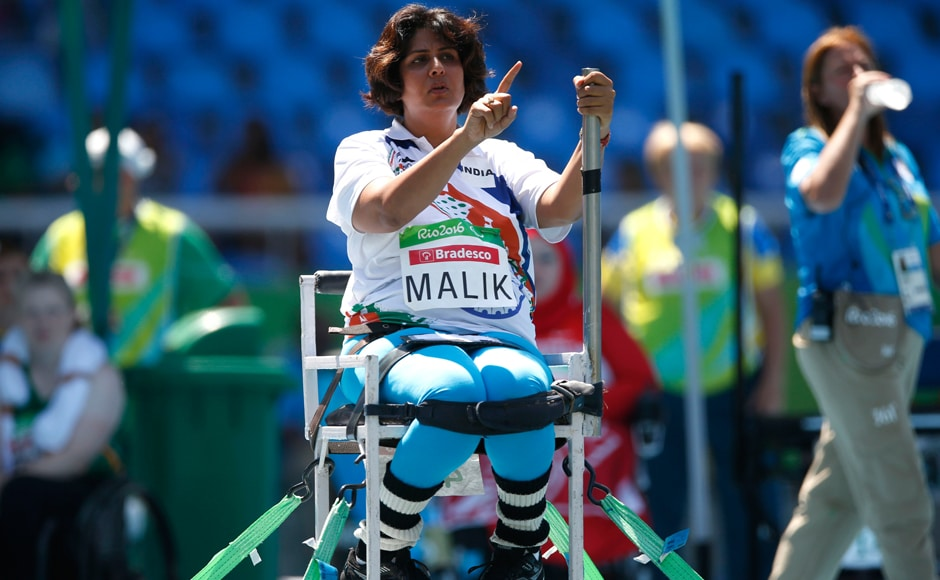 Deepa gestures as she competes in the women's final shot put F53 athletics event. AP