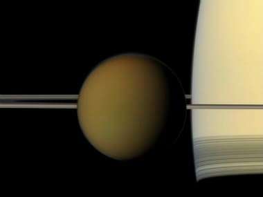 The hazy globe of Titan hangs in front of Saturn and its rings in this natural color view from NASA's Cassini spacecraft. (Photo: NASA/JPL-Caltech/Space Science Institute)