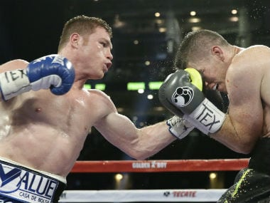Saul Canelo Alvarez (left) in action during his title bout against Liam Smith. AP