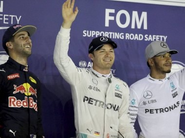 Nico Rosberg waves after taking pole position during the qualifying session for the Singapore GP. AP
