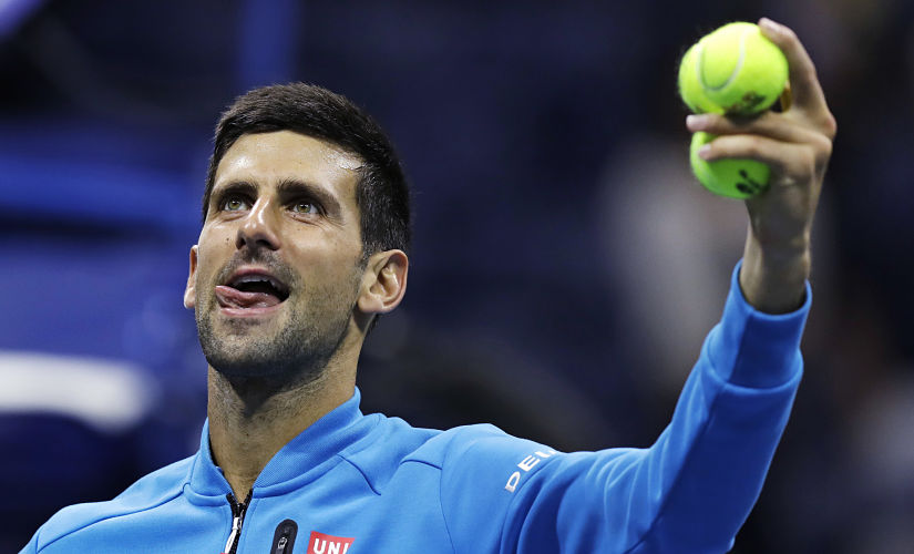 Novak Djokovic looks toward the crowd after his match against Jo-Wilfried Tsonga. AP