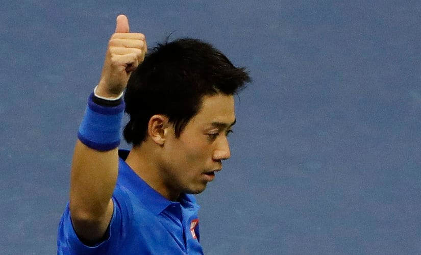 Kei Nishikori, of Japan gives a thumbs up after beating Andy Murray. AP