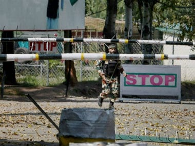 Soldier outside the army camp which was attacked in Uri. PTI