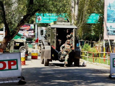 Army soldiers rush to the attack site in Uri. PTI