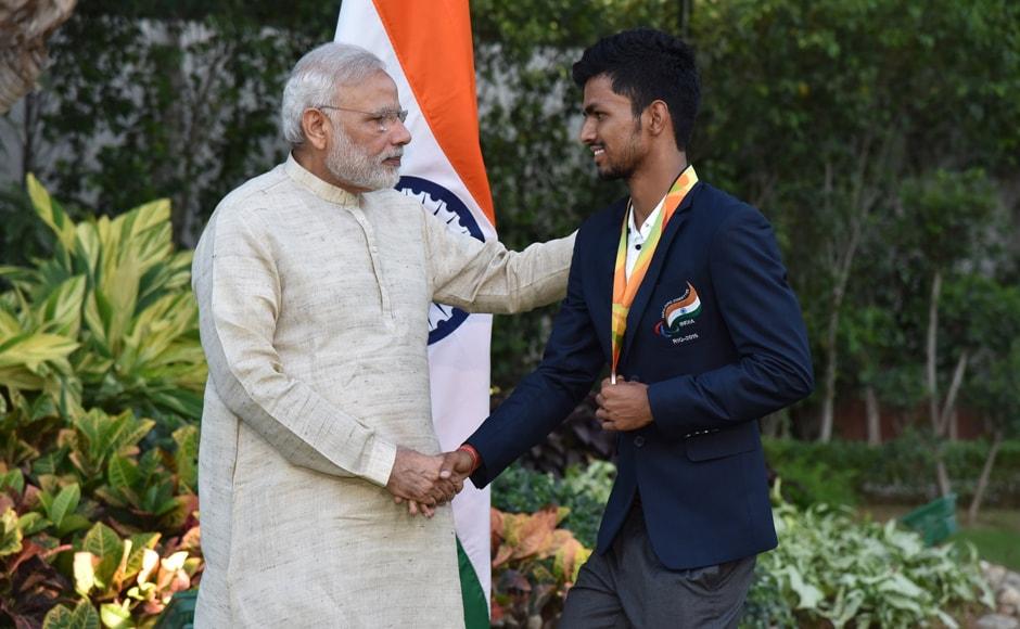 PM Narendra Modi with bronze medallist Varun Singh Bhati. Image courtesy: Twitter/@narendramodi