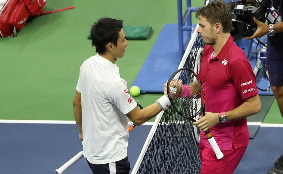 Kei Nishikori congratulates Stan Wawrinka (right) after the latter's win in four sets in the semi-final of the US Open 2016 men's singles event. Reuters