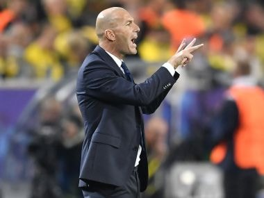 Real Madrid coach Zinedine Zidane gestures to his players during their Champions League tie against Borussia Dortmund. AP