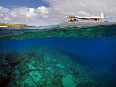 A tourist boat floats above an area called the 'Coral Gardens' located off Lady Elliot Island and north-east from the town of Bundaberg in Queensland, Australia. Reuters