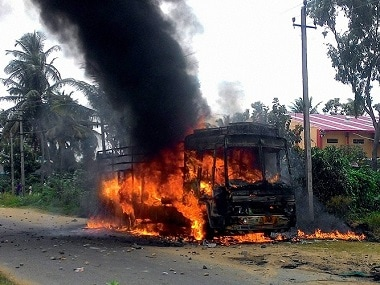 A file image of a vehicle in flames after it was torched by pro-Kannada activists during a protest over Cauvery water row, in Mandya district. PTI